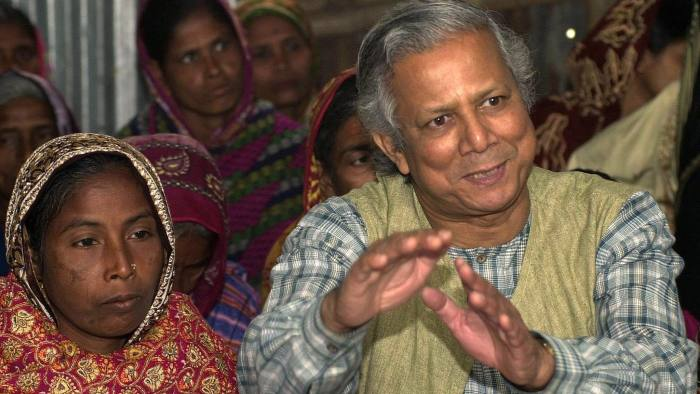 YUNUS AND VILLAGERS...** FILE ** In a file photo Professor Mohammad Yunus, founder of Grameen Bank, a micro credit institution, explains to villagers the benefits of the system at Kalampur village in Dhaka, Bangladesh, Jan. 21, 2004. Yunus and the Grameen Bank were awarded the N0bel Peace Prize Friday Oct. 13, 2006, in Oslo, Norway. (AP Photo/Pavel Rahman)