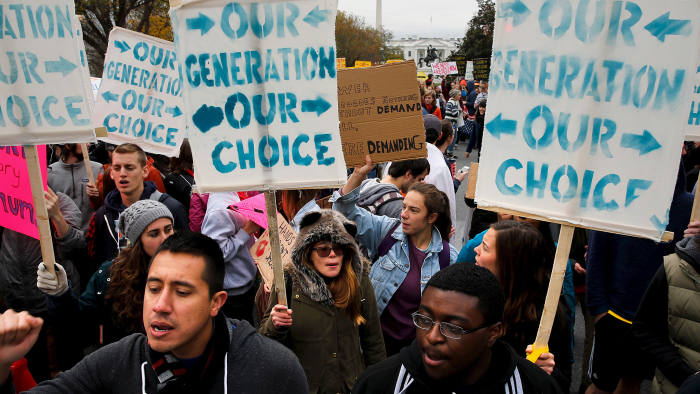 Students participate in the 'Our Generation, Our Choice' protest near the White House in Washington November 9, 2015. The Monday march to highlight race, climate, and immigration issues was timed to mark exactly one year until the 2016 U.S. presidential election, according to protesters. REUTERS/Jonathan Ernst TPX IMAGES OF THE DAY - GF20000052126