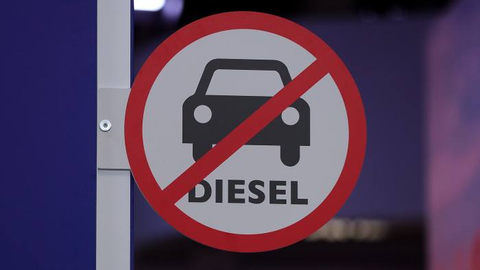 A 'no diesel' sign sits on the Iveco Ltd truck exhibition stand on display at the IAA Commercial Vehicles Show in Hanover, Germany, on Wednesday, Sept. 19, 2018. Volkswagen AGs truck unit is pushing to reduce its dependence on its main European market and lift profit margins in a challenge to commercial-vehicle industry leaders Daimler AG and Volvo AB. Photographer: Krisztian Bocsi/Bloomberg