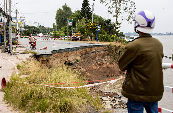A piece of the national road named 91, collapsed into Hau river over 3 months ago, after being eroded from below. Now the road is temporary blocked and awaits for fixing solutions.