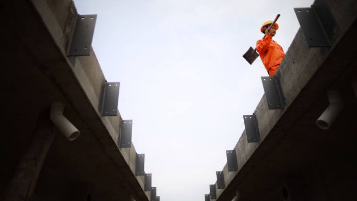 Mandatory Credit: Photo by Xinhua/Shutterstock (10609218f) A worker makes precast beam at a beam production site for the construction of a fast railway in Guiyang, southwest China's Guizhou Province, April 10, 2020. The construction of the southwest ring road fast railway in Guiyang has been resumed in an orderly manner under strict measures taken to fight against the COVID-19. China Guizhou Guiyang Railway Construction - 10 Apr 2020