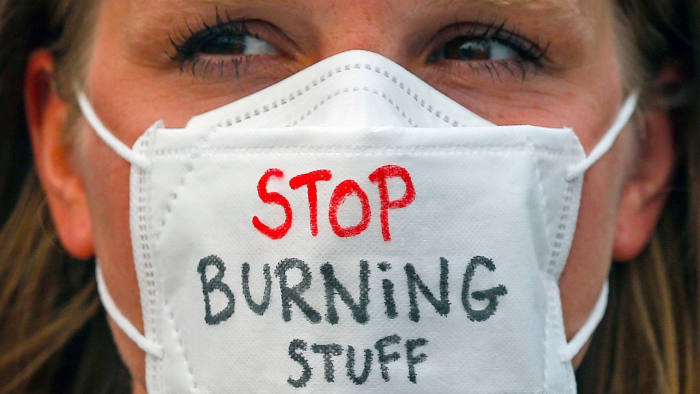 Mandatory Credit: Photo by FAZRY ISMAIL/EPA-EFE/Shutterstock (10420120a) An environmental activist wears a mask with the words 'STOP BURNING STUFF' during a rally part of the international Global Climate Strike in Kuala Lumpur, Malaysia, 21 September 2019. The strikes are happening in cities across the world just days before United Nations' Climate Action Summit on 21 September in New York, where nations will ramp up their ambitions to curb greenhouse gases under the 2015 Paris climate agreement. A second worldwide climate strike is planned for 27 September. Global Climate Strike Rally in Malaysia, Kuala Lumpur - 21 Sep 2019