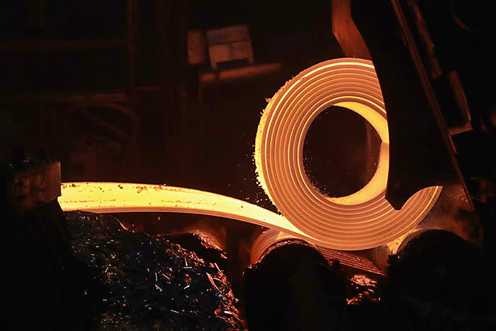 """PORTAGE, IN - MARCH 15: A slab of steel, 8 inches thick, is heated and rolled into a coil of steel, 1/10 to 3/4 inches thick, at the NLMK Indiana steel mill on March 15, 2018 in Portage, Indiana. The mill, which is projected to produce up to 1 million tons of steel from recycled scrap in 2018, is considered a """"mini mill"""" by U.S standards. NLMK Indiana is a subsidiary of NLMK, one of Russia's largest steel manufacturers, responsible for nearly a quarter of Russias steel production and producing nearly a quarter of the worlds slab steel. Steel producers in the U.S. and worldwide are preparing for the impact of the recently-proposed tariffs by the Trump administration of 25 percent on imported steel. (Photo by Scott Olson/Getty Images)"""