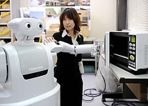 Japan is a leading developer of robots designed to help humans: Toshiba's 'ApriAttenda' housekeeper can open a fridge door