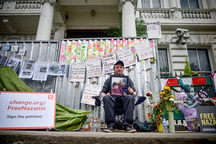 LONDON, ENGLAND - JUNE 20: Richard Ratcliffe holds a protest outside the Iranian embassy on June 20, 2019 in London, England. Richard Ratcliffe's British-Iranian wife, Nazanin Zaghari-Ratcliffe, was jailed in Iran in 2016 on spying charges, which she and the British government deny. She recently began a hunger strike to protest her continued detention at Evin prison in Tehran. (Photo by Peter Summers/Getty Images)