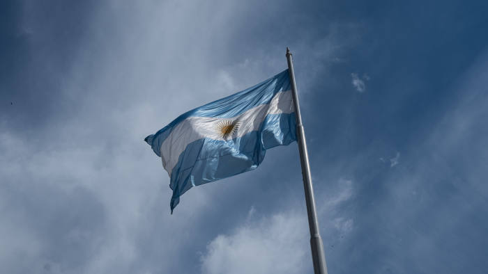 An Argentine flag stands on display in Plaza de Mayo in Buenos Aires, Argentina, on Monday, Sept. 2, 2019. Argentines and investors alike are cautiously assessing the impact of PresidentMauricio Macri's decision to impose capital controls on Sunday -- a blunt policy reversal aimed at containing the country's escalating financial crisis. Photographer: Erica Canepa/Bloomberg