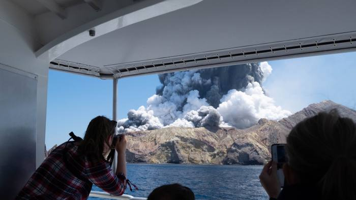 Editorial use only. MANDATORY CREDIT: MICHAEL SCHADE /NO SALES Mandatory Credit: Photo by MICHAEL SCHADE/EPA-EFE/Shutterstock (10495187b) An image provided by visitor Michael Schade shows White Island (Whakaari) volcano, as it erupts, in the Bay of Plenty, New Zealand, 09 December 2019. According to police, at least five people have died in the volcanic erruption at around 2:11 pm local time on 09 December. The island is located around 40km offshore of the Bay of Plenty. New Zealand's White Island volcano erupts - 09 Dec 2019