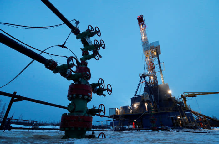 FILE PHOTO: A view shows a well head and a drilling rig in the Yarakta Oil Field, owned by Irkutsk Oil Company (INK), in Irkutsk Region, Russia March 11, 2019. Picture taken March 11, 2019. REUTERS/Vasily Fedosenko/File Photo