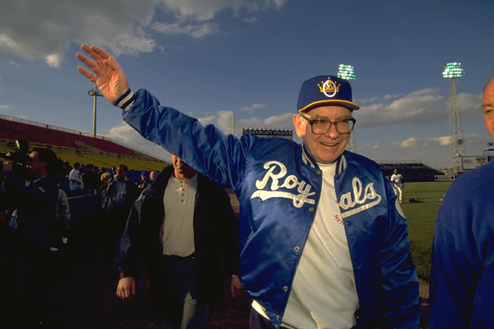 "At an Omaha Royals baseball game in 1997; Buffett was a minority owner of the team between 1991 and 2012, and still enjoys attending games with his employees: ""I've got 25 people out here. We go to baseball games together. They try to make my life good, I try and make their life good"""