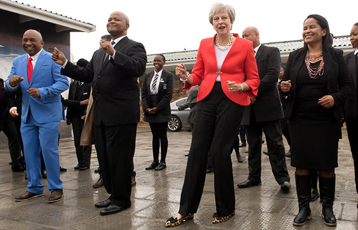 Prime Minister Theresa May dancing with students and staff at I.D. Mkize Secondary School in Cape Town, which is twinned with Whitby High School in Yorkshire. The two schools are part of a British Council funded teacher exchange scheme called 'Connected Classrooms'. The prime minister is on day one of her trip to South Africa, Nigeria and Kenya on a trade mission designed to bolster the UK's post-Brexit fortunes. PRESS ASSOCIATION Photo. Picture date: Tuesday August 28, 2018. See PA story POLITICS Africa. Photo credit should read: Stefan Rousseau/PA Wire