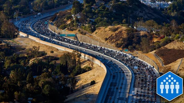 Vehicles sit in rush hour traffic on the Interstate 405 freeway through the Sepulveda pass in this aerial photograph taken over Los Angeles, California, U.S., on Friday, July 10, 2015. The greater Los Angeles region routinely tops the list for annual traffic statistics of metropolitan areas for such measures as total congestion delays and congestion delays per peak-period traveler. Photographer: Patrick T. Fallon/Bloomberg