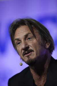 """US actor Sean Penn speaks during a working session for """"Action Day"""" at the COP21 United Nations conference on climate change in Le Bourget on December 5, 2015. AFP PHOTO / ERIC FEFERBERGERIC FEFERBERG/AFP/Getty Images"""