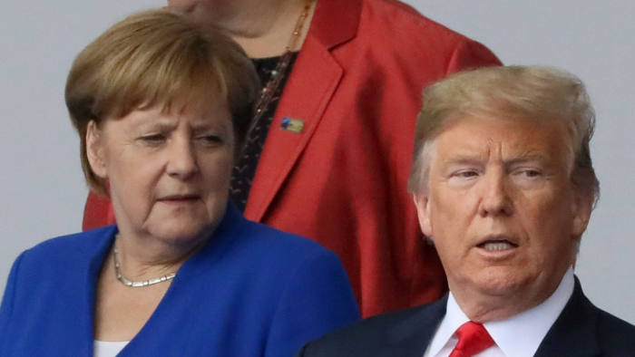 FILE PHOTO: German Chancellor Angela Merkel and U.S. President Donald Trump are seen as they pose for a photo at the start of the NATO summit in Brussels, Belgium July 11, 2018. REUTERS/Reinhard Krause/File Photo