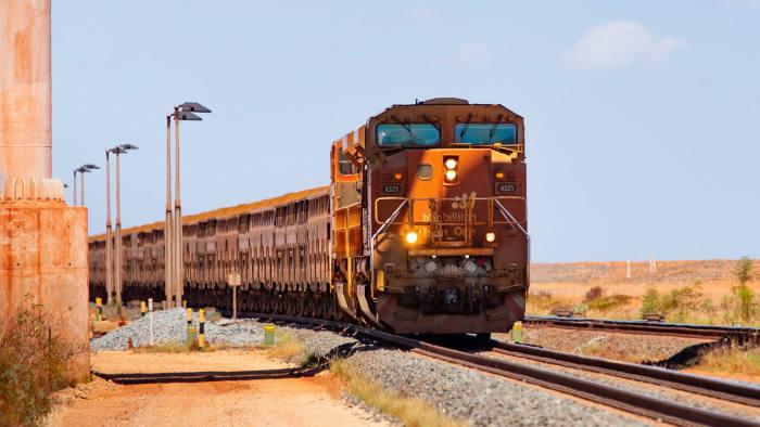A BHP freight train carrying iron ore towards Port Hedland, Western Australia