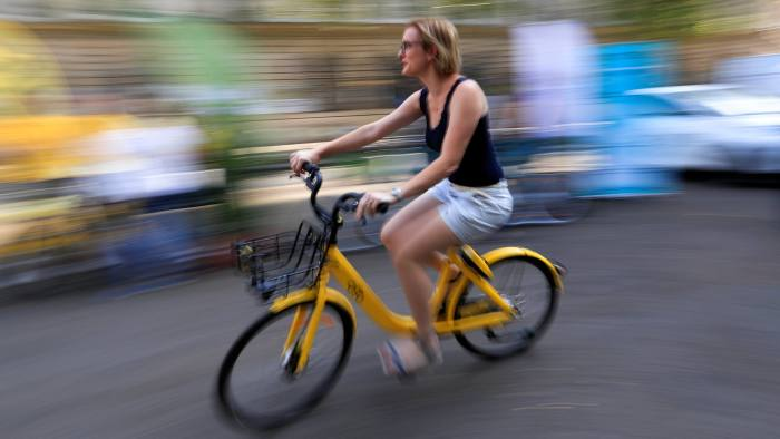 A woman rides a bike-sharing service Ofo bicycle during a presentation of new alternative urban mobility options at Paris city hall, France, July 19, 2018. REUTERS/Gonzalo Fuentes