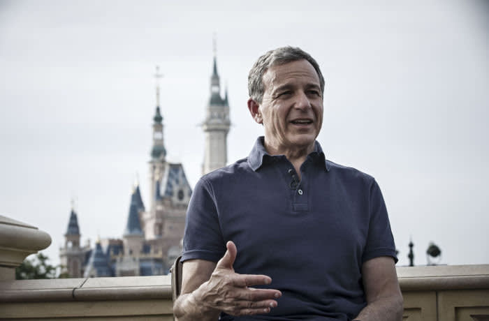Bob Iger, chief executive officer of Walt Disney Co., speaks during a Bloomberg Television interview at Disneyland in Shanghai, China, on Friday, June 16, 2017. Iger said he stepped down from Donald Trump's jobs panel two weeks ago following the president's decision to exit the Paris Accord on climate change because businesses must accept responsibility to protect the environment. Photographer: Qilai Shen/Bloomberg