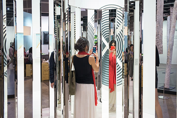 HONG KONG, HONG KONG - MARCH 29: A woman looks at artworks at the Art Basel Hong Kong fair on its first day open to the public on March 29, 2018 in Hong Kong, Hong Kong. The sixth annual Art Basel in Hong Kong opened to the public from March 29 to 31, 2018. (Photo by Billy H.C. Kwok/Getty Images)