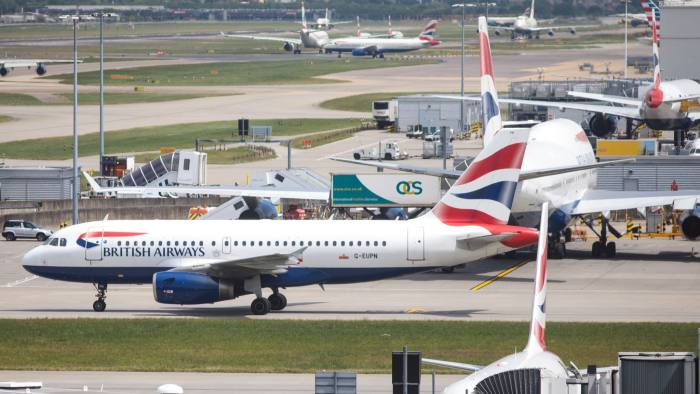 LONDON, ENGLAND - MAY 28: British Airways aircraft on the tarmac at Heathrow Airport Terminal 5 on May 28, 2017 in London, England. Thousands of passengers face a second day of travel disruption after a British Airways IT failure caused the airline to cancel most of its services. (Photo by Jack Taylor/Getty Images)