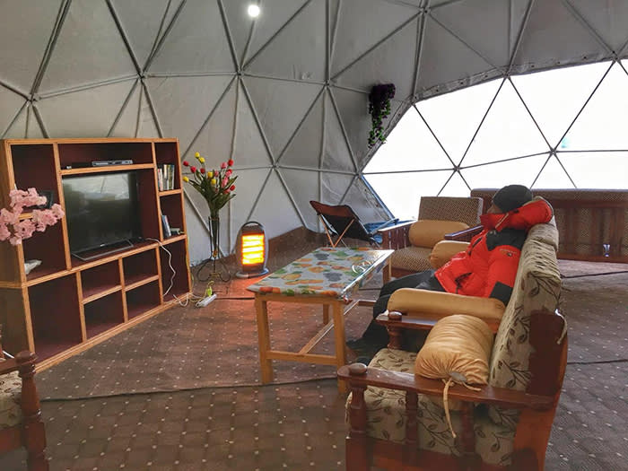 A climber relaxes at Furtenbach Adventures' base camp, on the Tibetan side of Everest
