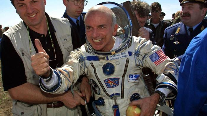 ARKALYK, KAZAKHSTAN: US space tourist Dennis Tito celebrates after his landing near the Kazakh town of Arkalyk (some 300 km from Astana), 06 May 2001. The world's first-ever space tourist Dennis Tito hailed a trip to Paradise after the US millionaire and two Russian cosmonauts successfully landed back on earth. AFP PHOTO/ ALEXANDER NEMENOV. (Photo credit should read ALEXANDER NEMENOV/AFP/Getty Images)