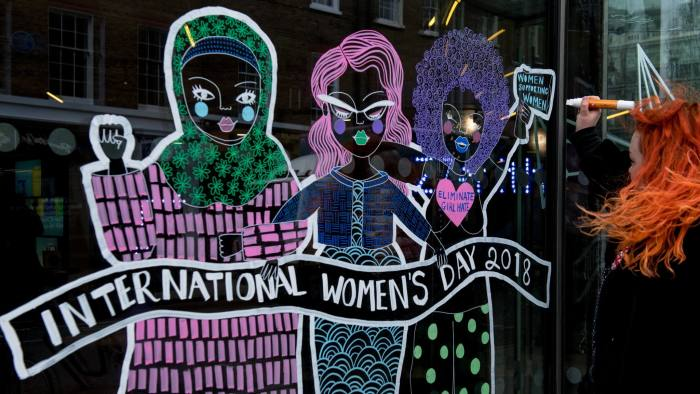 LONDON, ENGLAND - MARCH 08:  A woman draws a mural on a office window in Fitzrovia during International Women's Day on March 8, 2018 in London, United Kingdom. International Women's Day is annually held on March 8 to celebrate women's achievements throughout history and across nations. It is also known as the United Nations (UN) Day for Women's Rights and International Peace.  (Photo by Chris J Ratcliffe/Getty Images)