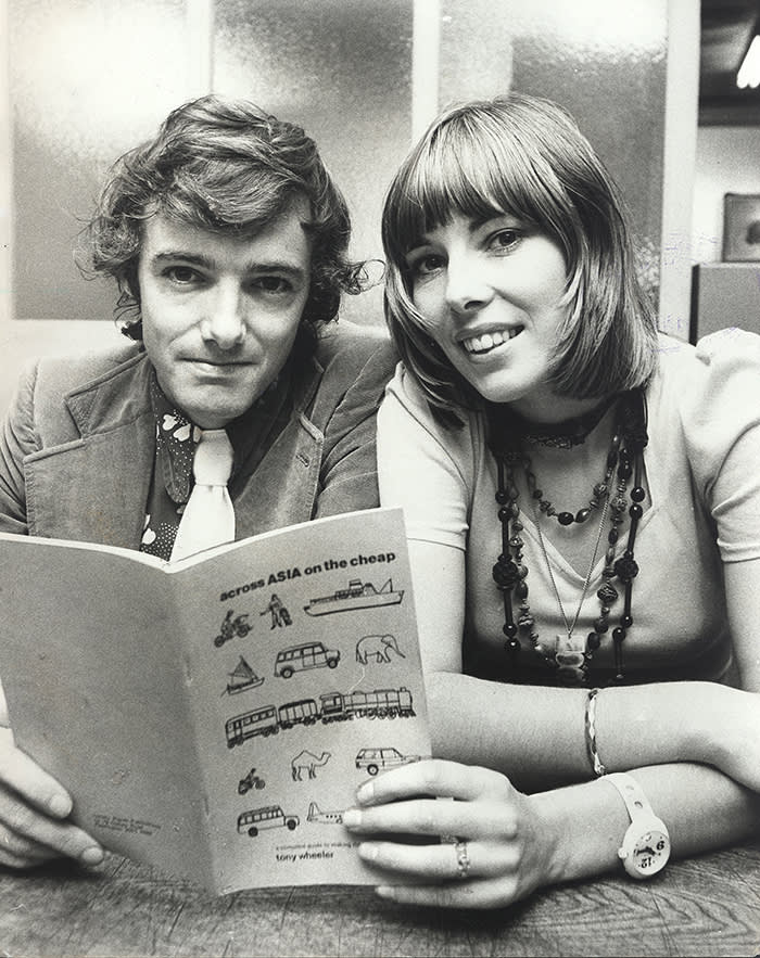 (AUSTRALIA OUT) Travel authors Tony and Maureen Wheeler with their book 'Across Asia on the Cheap', 8 November 1973. SMH Picture by TED GOLDING (Photo by Fairfax Media/Fairfax Media via Getty Images)