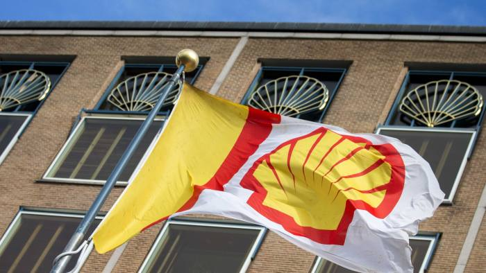 epa05840421 (FILE) A file photo dated 30 July 2015 showing a company flag flying in front of the head office of Royal Dutch Shell in The Hague, The Netherlands. Royal Dutch Shell plc on 09 March 2017 said they would sell all but 10 per cent of their Canadian oil sands production assets to Canadian Natural Resources. The sale is part of Shell's efforts to reduce debt and reduction of activity in environmentally sensitive methods to extract fossil fuels.  EPA/JERRY LAMPEN