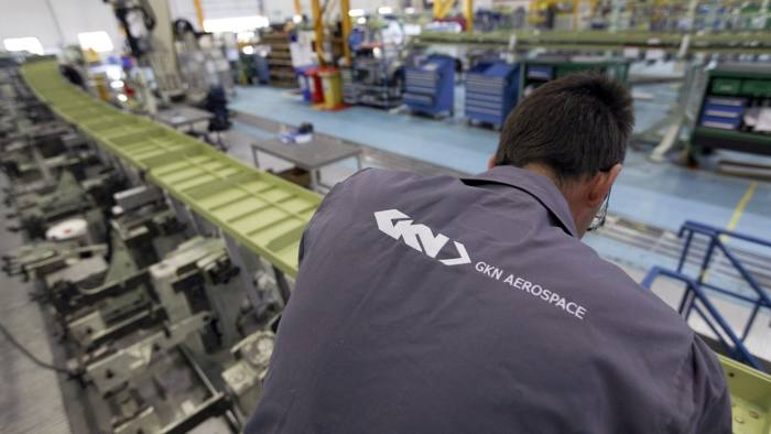 The GKN Aerospace logo is seen on the overalls of an employee as he works on a trailing wing edge of an Airbus SAS A380 aircraft, a unit of European Aeronautic, Defence & Space Co. (EADS), at GKN Plc's factory in Filton, U.K., on Wednesday, Sept. 12, 2012. GKN completed its acquisition of Volvo AB's aircraft-engine unit, Volvo Aero, for 633 million pounds to tap demand for lightweight composite parts and narrow the gap with competitors such as Safran SA, earlier this month. Photographer: Chris Ratcliffe/Bloomberg