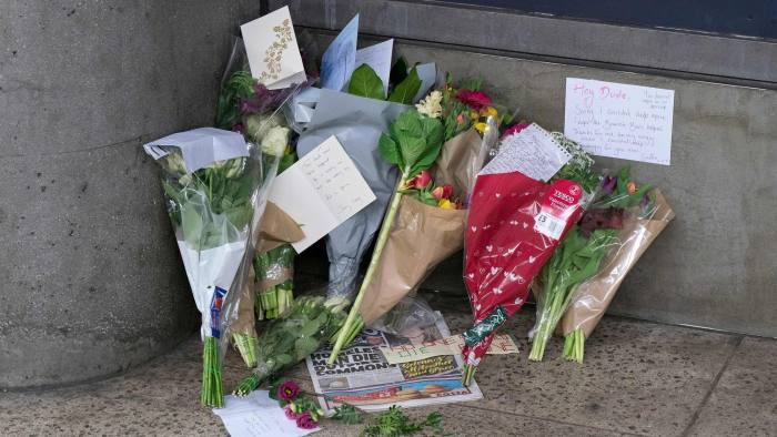 (FILES) In this file photo taken on February 16, 2018 A collection of votive flowers and notes are seen where an unnamed Portuguese man was found dead on February 14, 2018 in the underpass at Westminster Underground Tube station near the Houses of Parliament in London on February 16, 2018. - Almost 600 homeless people in England and Wales died during the last year -- a 24 percent rise over the past five years, the Office for National Statistics estimated on December 20, 2018. (Photo by Justin TALLIS / AFP)JUSTIN TALLIS/AFP/Getty Images