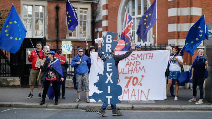 Pro and anti-Brexit protesters are seen in the street near the venue of a Brexit Party European Parliament election campaign rally at Olympia London, west London, on May 21, 2019. - Despite voting in a referendum to leave the European Union in 2016 Britain is braced to take part in the European Parliament election on May 23. (Photo by Tolga Akmen / AFP) (Photo credit should read TOLGA AKMEN/AFP/Getty Images)