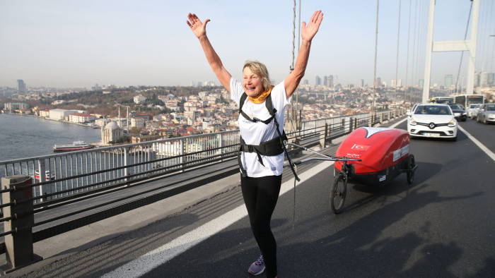 ISTANBUL, TURKEY - DECEMBER 20: 73-year-old British runner Rosie Swale Pope is seen continuing her journey as part of campaign for Nepal crossing Bosphorus-15 July Martyrs Bridge by foot, on December 20, 2019 in Istanbul, Turkey. British adventurer on Friday crossed Istanbuls iconic Bosphorus Bridge on foot as part of a 6,000-mile journey to support the people of Nepal. For her bridge run, she had to get special permission from Istanbuls Governorship, as the Bosphorus (15 July Martyrs) Bridge is not normally open for foot crossings. (Photo by Elif Ozturk/Anadolu Agency via Getty Images)