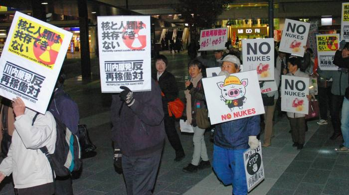 Signs of protest: anti-nuclear demonstrators last November as the Kagoshima prefectural assembly approves resumption of the Sendai nuclear power plant in Matsumoto, Nagano, Japan