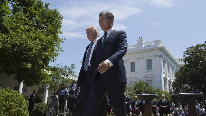 epa06058442 US President Donald J. Trump (L) and President of South Korea Moon Jae-in (R) walk away from the podiums after making joint statements in the Rose Garden of the White House in Washington, DC, USA, 30 June 2017. South Korea's President Moon and US President Trump met to discuss a variety of security and trade issues during Moon's first visit to the US since becoming President. EPA/MICHAEL REYNOLDS