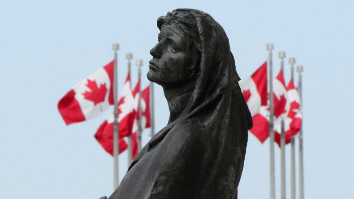 The statue of Veritas (Truth) is shown in front of the Supreme Court of Canada in Ottawa on Wednesday, May 23, 2018. The Supreme Court of Canada says federal ministers do not have a duty to consult Indigenous groups when drafting legislation. THE CANADIAN PRESS/Sean Kilpatrick