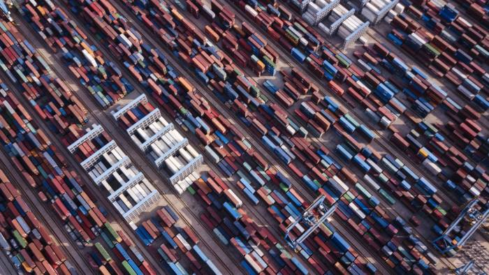 Shipping containers stand at the Qingdao Qianwan Container Terminal in this aerial photograph taken in Qingdao, China, on Monday, May 7, 2018. China's overseas shipments exceeded estimates while imports surged, as the global economy continued to support demand. Photographer: Qilai Shen/Bloomberg