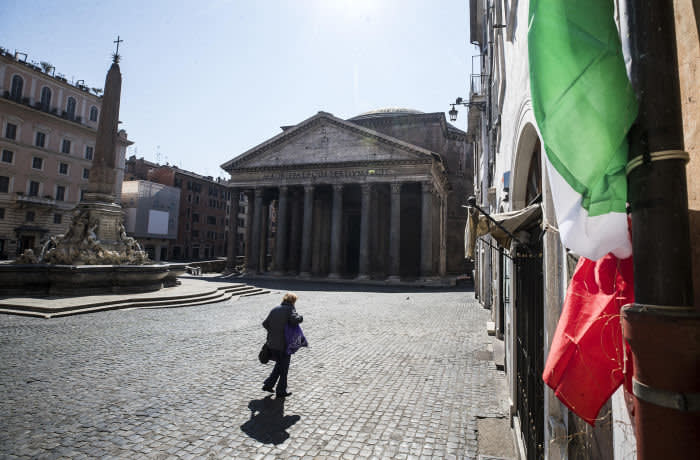 Mandatory Credit: Photo by ANGELO CARCONI/EPA-EFE/Shutterstock (10588163b) A woman with a protective face mask walks in front of the Pantheon during the emergency blockade of Covid-19 Coronavirus in Rome, Italy, 19 March 2020. Italy has reported at least 35,713 confirmed cases of the COVID-19 disease caused by the SARS-CoV-2 coronavirus and 2,978 deaths so far. The Mediterranean country remains in total lockdown as the pandemic disease spreads through Europe. Covid-19 Coronavirus emergency lockdown in Rome, Italy - 19 Mar 2020