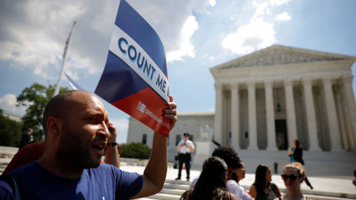 Counted: a protester outside the US Supreme Court, which ruled that the Trump administration did not give an adequate explanation for plans to add a citizenship question to the  census
