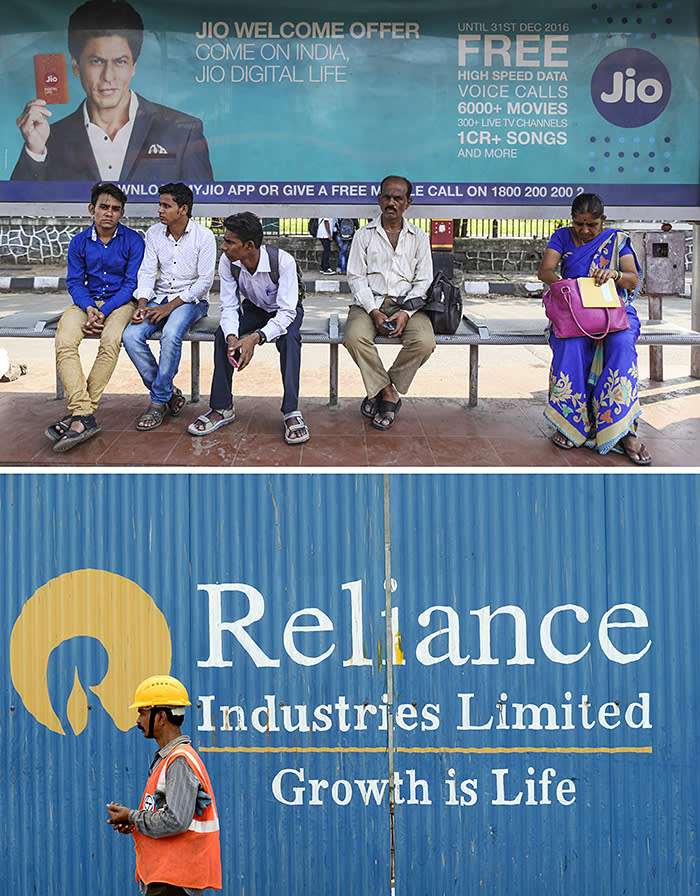 A worker walks past the signage of Reliance Industries Limited (RIL) at the site of an upcoming highrise at the Bandra Kurla Complex business district in Mumbai on August 4, 2016. India's GDP expanded 7.6 percent in 2015-16, making it the fastest-growing major economy in the world. / AFP PHOTO / INDRANIL MUKHERJEEINDRANIL MUKHERJEE/AFP/Getty Images