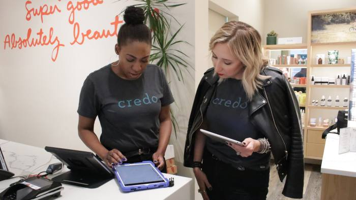 Credo employees use iPads to talk to online shoppers as well as help those in stores
