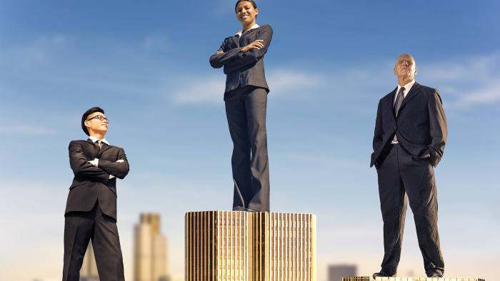 Illustration by hitandrun. must credit hitandrun / www.hitandrunmedia.com on all uses, with hitandrun all in lowercase without caps, as shown. Illustration shows three management consultants standing on top of londin buildings, arranged as an olympic opdium.