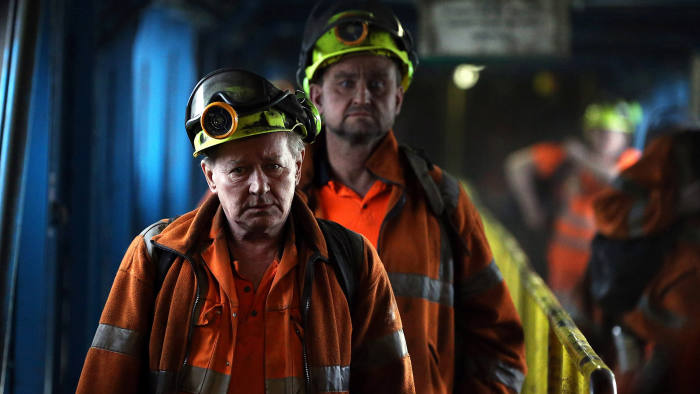 Coal miners finish the final shift before closure at the Kellingley Colliery in Yorkshire, northern England, on December 18, 2015. The shutdown of the mine in Yorkshire in northern England closes a 200-year chapter of Britain's industrial history. AFP PHOTO / POOL / NIGEL RODDIS / AFP / POOL / NIGEL RODDIS (Photo credit should read NIGEL RODDIS/AFP/Getty Images)