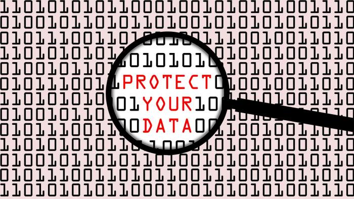 Image of magnifying glass hovering over lines of computer code. Highlighted are the words 'protect your data'
