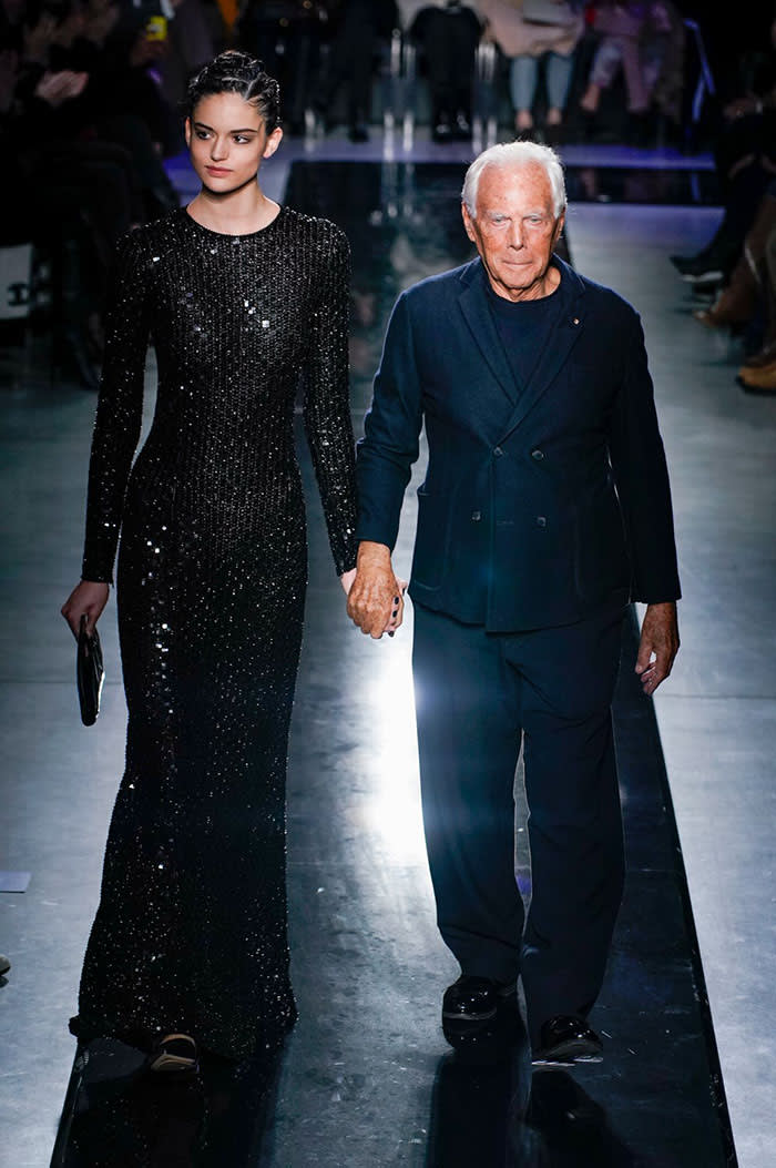 Designer Giorgio Armani appears with a model at his AW19 show