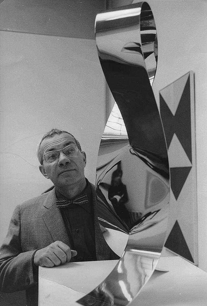 Artist and architect Max Bill with one of his sculptures at the Kunsthalle in Bern (on the occasion of his 60th birthday). 1968. Photograph (Photo by Votava/Imagno/Getty Images)
