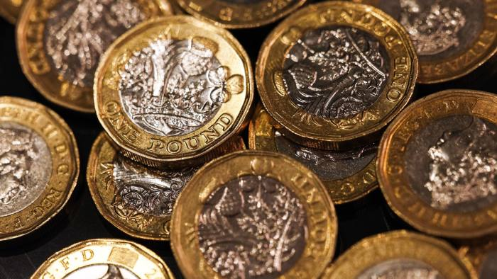 FILE: A collection of one pound sterling coins sit in this arranged photograph in London, U.K., on Wednesday, Aug. 15, 2018. U.K. Prime Minister Theresa May will put her Brexit deal to Parliament for a decisive vote on Dec. 11, but after her plan was savaged from all sides, the signs are she's on course to lose. The vote will mark the moment when British politicians decide whether to accept the contentious divorce terms May has struck with the European Union -- or put the country on course to crash out of the bloc with no agreement in place. Our editors look back at some of the key photographs that capture the Brexit journey. Photographer: Chris Ratcliffe/Bloomberg