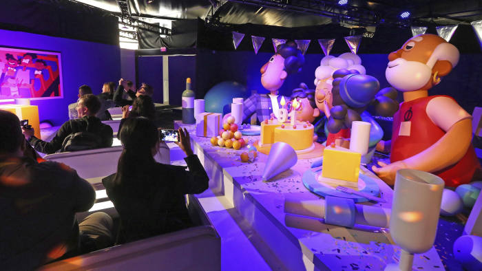 The Google Assistant ride shows off the new features in its voice-enabled digital assistant as visitors ride along at the Google display area at CES International Tuesday, Jan. 8, 2019, in Las Vegas. (AP Photo/Ross D. Franklin)