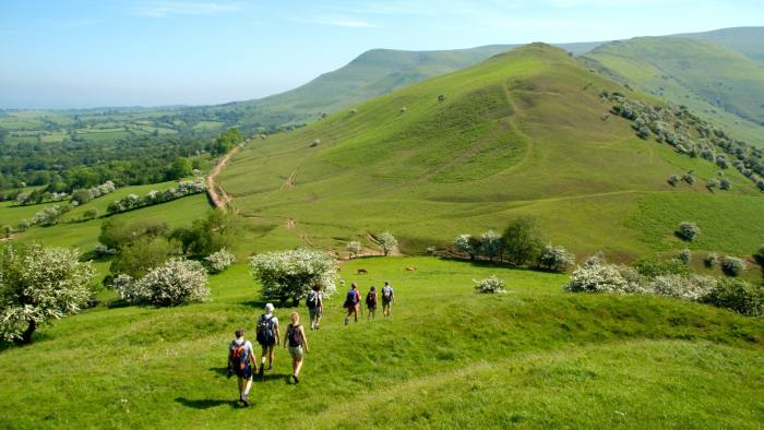AD5DG5 Guided walking group at Castell Dinas in Black Mountains near Pengenffordd Powys South Wales UK heading toward the Dragons Back