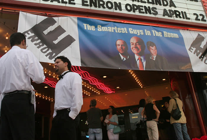 Valet parking attendants stand ready as film-goers line up for the premiere of the Enron documentary