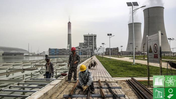 Workers labor at a construction site at the Sahiwal coal power plant, owned by China's state-owned Huaneng Shandong Rui Group, in Sahiwal, Punjab, Pakistan, on Wednesday, June 14, 2017. Pakistan is racing to bridge its power supply gap before national elections next year after a series of widespread blackouts highlighted the fragility of the network and its negative pull on South Asia's second largest economy. Photographer: Asad Zaidi/Bloomberg