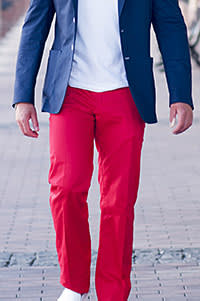 A man wearing red trousers
